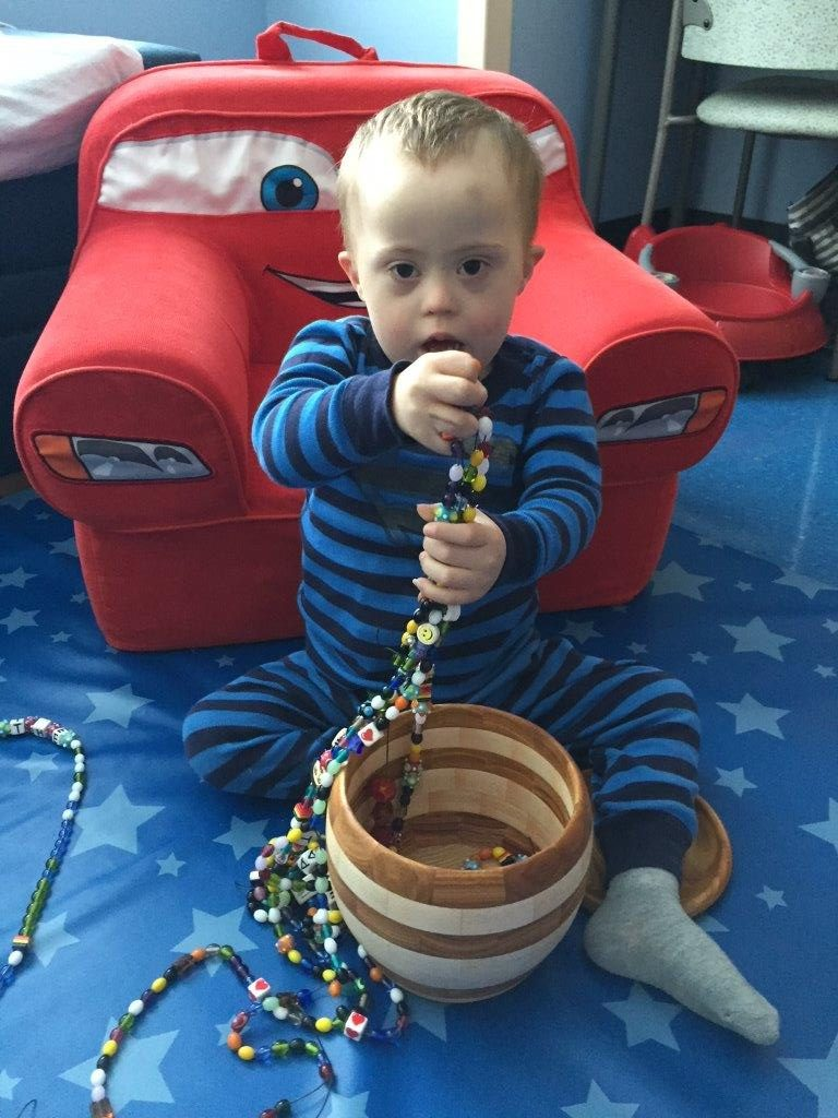 child with Beads of Courage and box